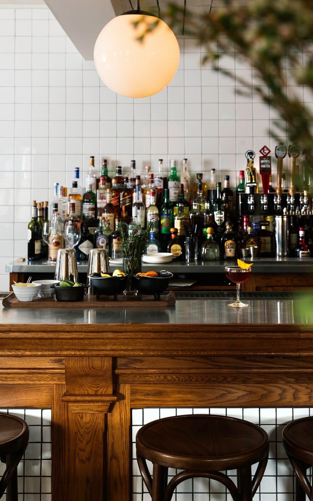 Craft cocktail hotel bar with bottles of premium liquor