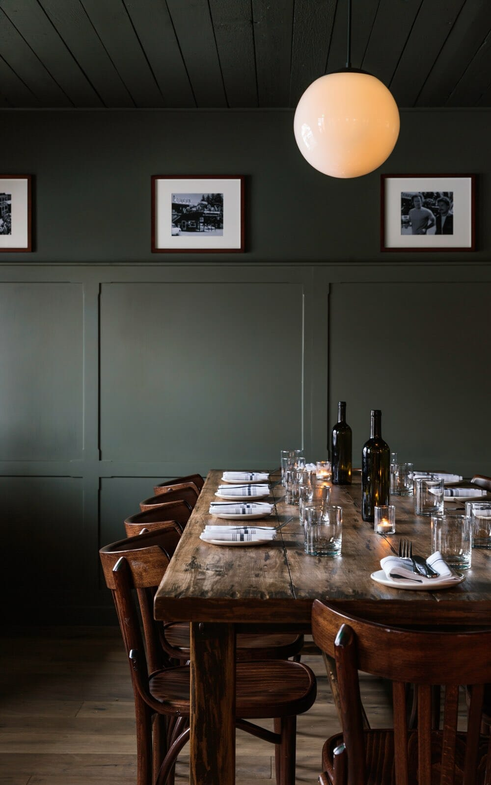 Glorietta restaurant dark wood table with chairs and seating for five people