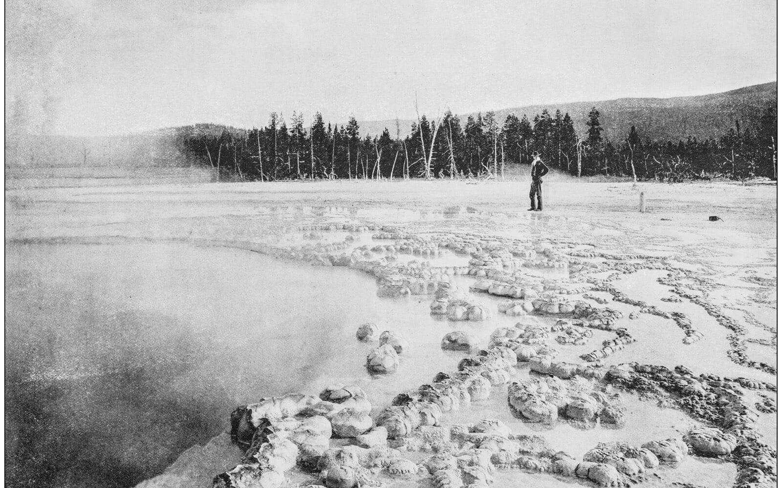 Vintage images of cowboy standing next to Jackson Hole in Wyoming