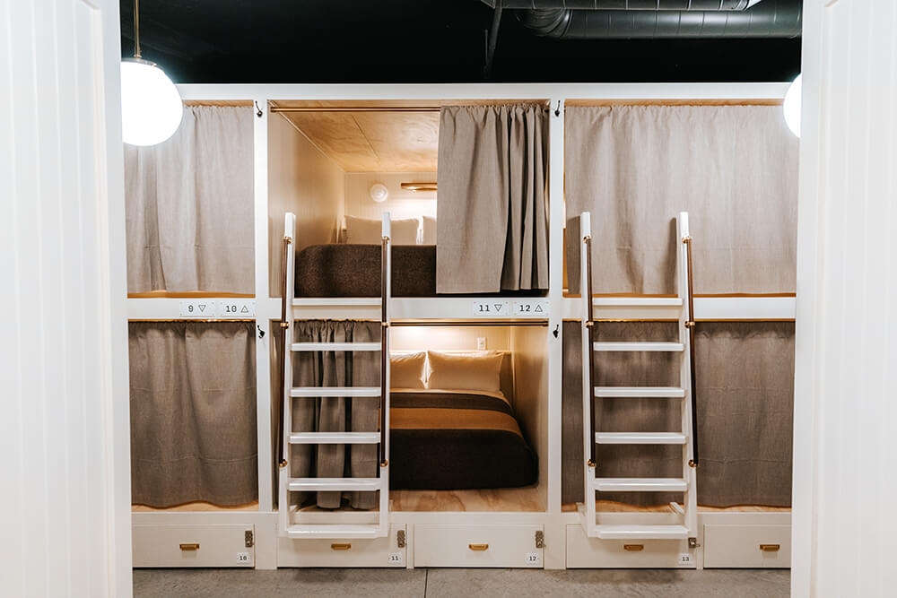 Bunk rooms with ladder and open curtain and bunk rooms with privacy curtain