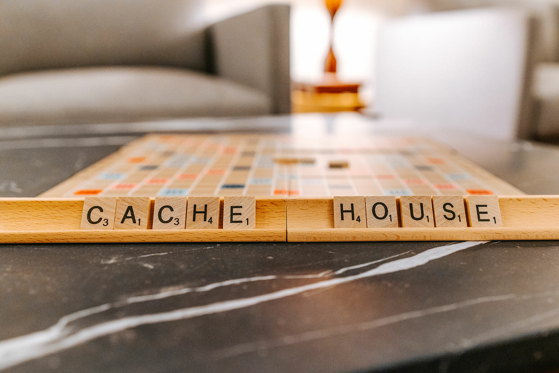 Cache House spelled out in scrabble letters in community room